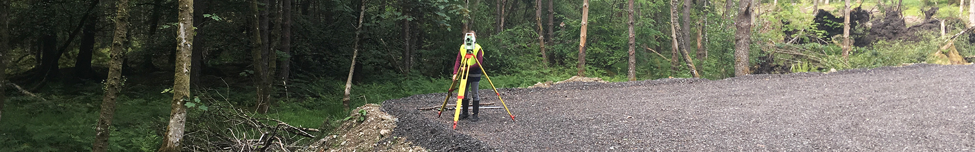 Total Station equipment set up within a courtyard